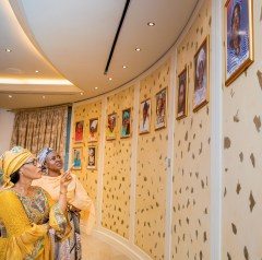 Conducting Mrs. Barrow round the pictures of former Nigerian First Ladies