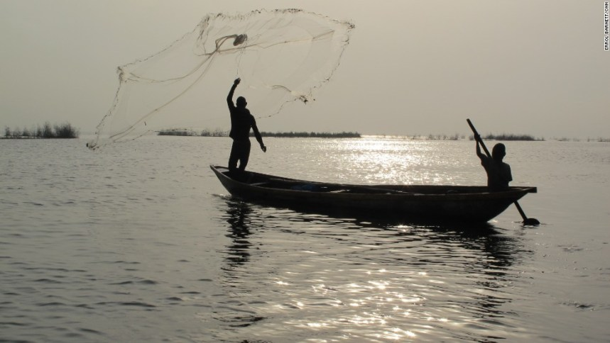 Man throwing his fishing net. [PHOTO CREDIT: CNN]