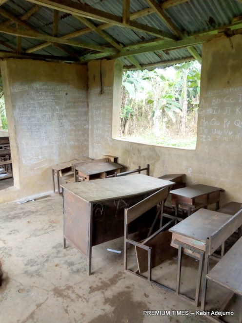 One of the classrooms at the Community School, Koola with broken chairs and tables