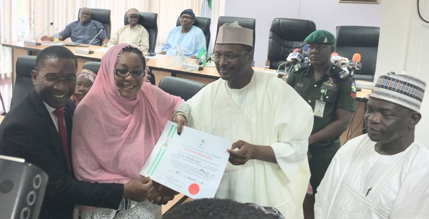 Image result for INEC presents certificates of registration to new parties