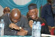 Senator Godswill Akpabio (right) smiles at Mr John Udoedehe at Akwa Ibom APC Caucus meeting on Saturday in Uyo