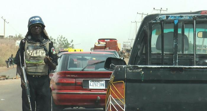 A Nigerian Police officer on the checkpoint