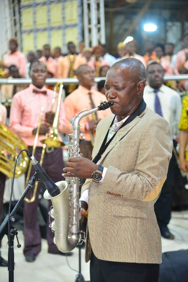 A saxophonist performing at the Redeemed Church annual convention