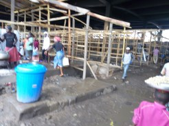 traders reconstructing their temporary shops that engulfed by fire last month at the Jos Main Market