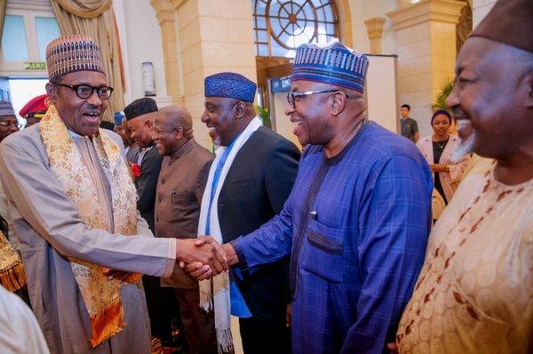 President Muhammadu Buhari exchanging pleasantries with Nigerian dignitaries in China (Photo Credit: Bashir Ahmad on Twitter)