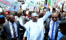 Former Vice President of Nigeria and frontline presidential aspirant of the Peoples Democratic Party (PDP), Atiku Abubakar acknowledging cheers from crowd of supporters who thronged the PDP national secretariat when Atiku submitted his Nomination and Expression of Interest forms in Abuja on Thursday.