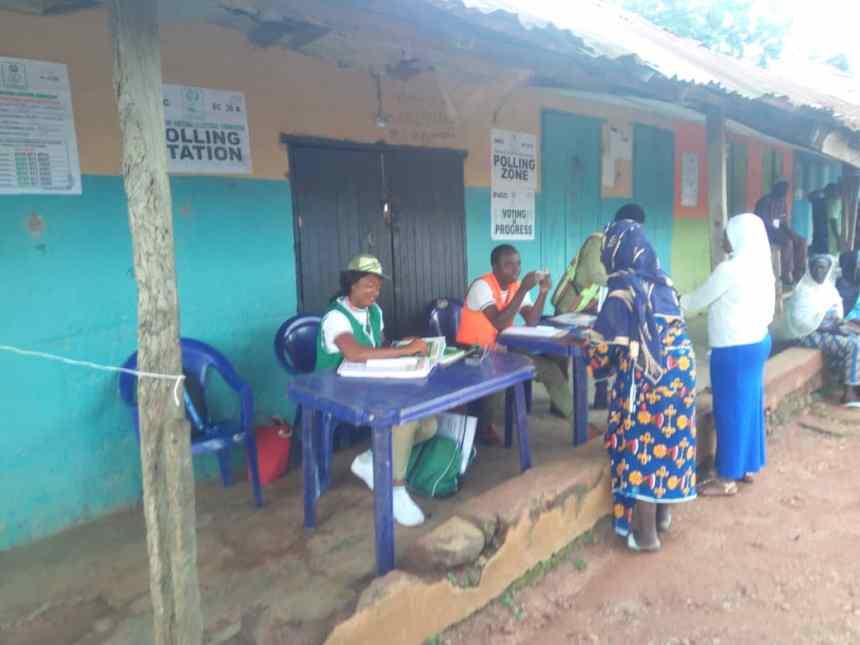 9.15am. At Ward1,PU7, local govt library 1,Orolu LGA voting has since commenced, with a total of 282 registered voters. Here is an elderly woman being attended to. The police and custom officers present confirmed that it has been peaceful so far.