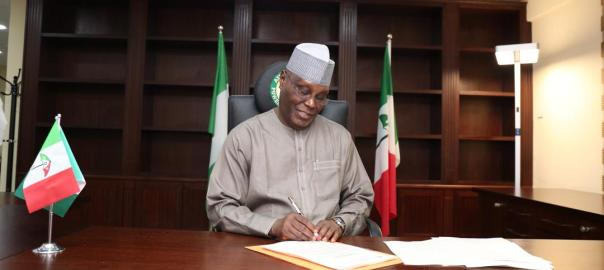 On this July 3, 2018 photo, Atiku Abubakar reviews some documents on his first day at his campaign headquarters in Abuja. (Credits: Atiku Campaign Organisation)
