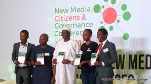 EIE director Yemi Adamolekun (second right) and Garba Abari director-general of National Orientation Agency (middle) unveiling a simplified version of the Nigerian Constitution at the second day of the 2018 edition of New Media, Citizens & Governance Conference.