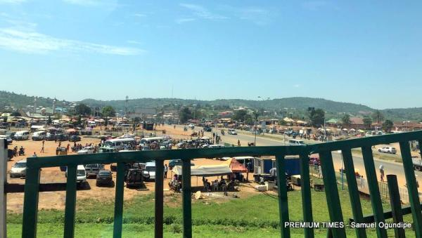 Nyanya Motor Park, 800 metres from Old Karu Bridge, is seen from the head of Nyanya Bridge a day after the violence. Normal human activities have now returned here. (October 30, 2018) Credits: Samuel Ogundipe/Premium Times.