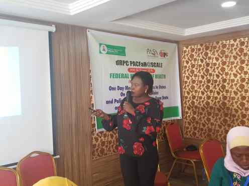 The first panelist Ms. JOYCE Ahmadu during her presentation on gender analysis of FP policies