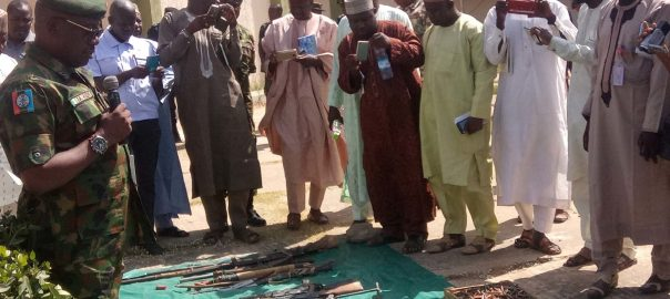 Acting Director of Defence Information, Nigerian Army, Brig.-Gen. John Agim (L), briefing Journalists on recovered arms on display, used by bandits to operate in Zamfara state on Tuesday (20/11/18). 05885/ 20/11/2018/TA/NAN