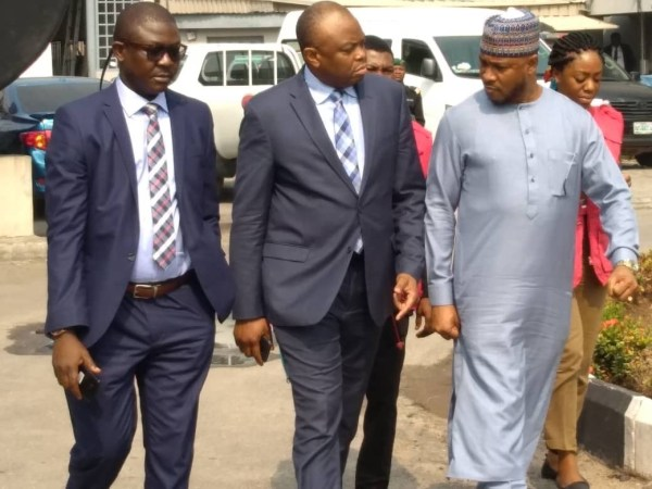 Messrs Okonkwo and Lawal being led into the court room by EFCC operatives on Monday.