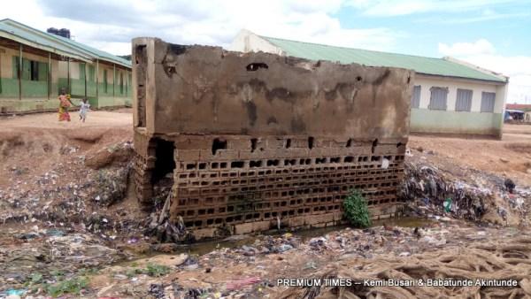 Erosion has eaten away the school toilet