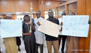 Some staff members of the National Assembly during a protest against alleged nonpayment of their allowances, poor remuneration and non-implementation of CONLESS, a new salary structure approved since 2010 for them, at the National Assembly in Abuja on Monday (4/12/18).