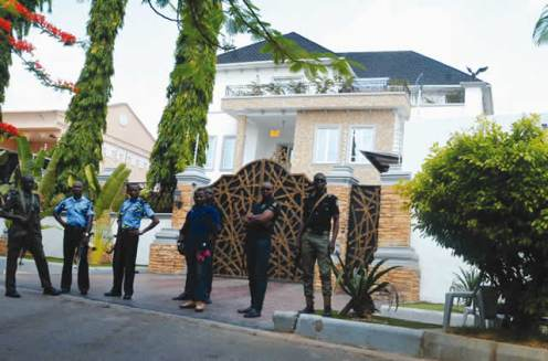 Police officers standing in front of Sen. Dino Melaye's house in Maitama, FCT