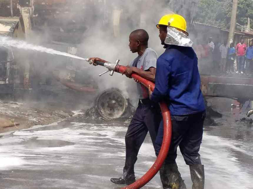 Men of the fire service putting out the fire