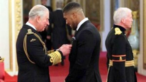 Anthony Joshua receiving the OBE from Prince Charles