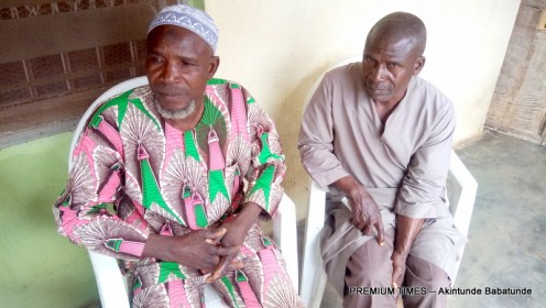 Alh. Yusuf Najim and his kinsman lamenting the efffect of the bad road on residents