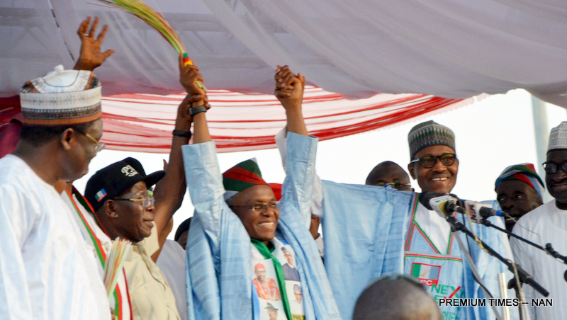 APC Presidential Candidate, President Muhammadu Buhari (R) assisted by APC National Chairman, Adams Oshiomhole while presenting the party's flag to the Kaduna State APC Gubernatorial Candidate, Nasir El-Rufai during Presidential rally at Ahmadu Bello Stadium in Kaduna on Friday (18/1/18) 00645//18/1/19/Ibrahim Bashir/ICE/NAN 00641 Pic 30. APC Presidential Candidate, President Muhammadu Buhari (L) with Kaduna State APC Gubernatorial Candidate, Gov Nasir El-Rufai during APC Presidential rally at Ahmadu Bello Stadium in Kaduna on Friday (18/1/18) 00646/18/1/19/Ibrahim Bashir/ICE/NAN Pic 31All Progressive Congress Party (APC) supporters during the party's Presidential rally at Ahmadu Bello Stadium in Kaduna on Friday (18/1/18) 00646/18/1/19/Ibrahim Bashir/ICE/NAN