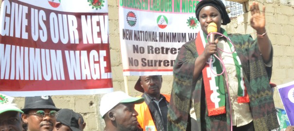 Chairperson of Nigeria Labour Congress (NLC), Mrs Mata Banki (R) addressing workers over non-implementation of the new minimum wage for workers, in Kaduna on Tuesday (8/1/19).