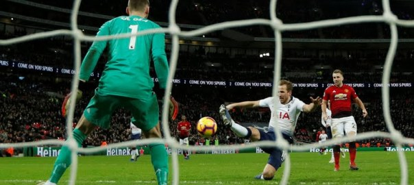 Tottenham's striker Harry Kane attempts a shot at goal saved by De Gea