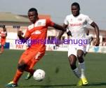 Abiodun Joseph of Sunshine Stars is challenged by Christian Madu of Rangers copy