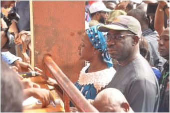 Edo State Governor, Mr. Godwin Obaseki (2nd left), his wife, Mrs. Betsy Obaseki (left), being accredited to vote at his polling unit (Ward 4, Unit 19), Emokpae Primary School in Benin City, on Saturday, February 23, 2019
