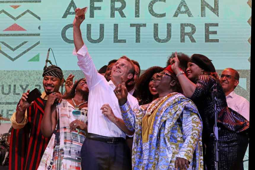 French president Emmanuel Macron with Nollywood artists during a live show in Lagos, Nigeria. EPA-EFE/Ludovic Marin