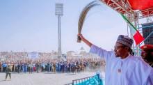 President Muhammadu Buhari waving during a campaign
