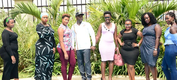 Uganda State Minister for Tourism Mr Godfrey Kiwanda with Ugandan models at the launch of 'Miss Curvy Uganda' at a Kampala hotel on February 5, 2019. PHOTO | GODFREY LUGAAJU | NMG