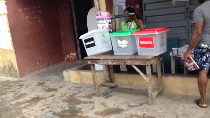 @8:37am, Ward 02 PU 012, Shomolu Lga Lagos East. The PO Is addressing the voters, confirming that the ballot boxes are empty.