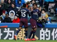 Alex Iwobi celebrates after scoring for Arsenal