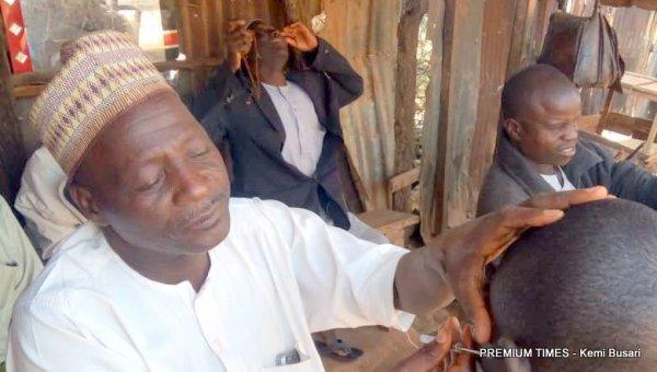 Mohammed shaving a customer
