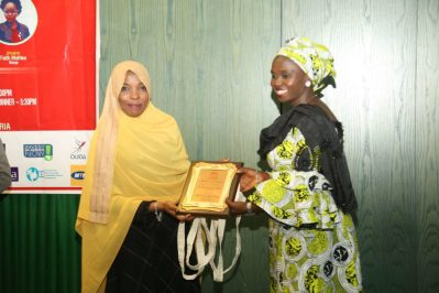 The Chairperson of the ANA Abuja chapter receiving an award in recognition of her efforts towards the development of African literature