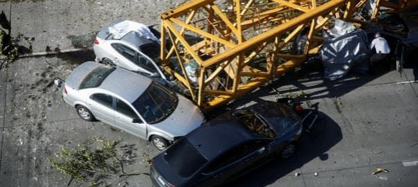 Part of a crane lies on top of cars in Mercer Street, Seattle. Photograph: Lindsey Wasson/Reuters