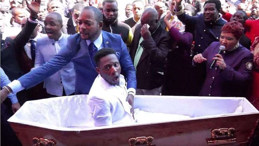 Briton Elliot pictured in the coffin who was reportedly raised from the dead by South African preacher Alph Lukau in blue has died (Photo ALPH LUKAU FACEBOOK) (1)