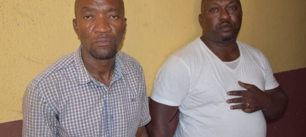 Police say Ogunyemi Olalekan (R) killed Kolade Johnson. His colleague, Godwin Orji (L), has been acquitted. (Photo Credit: Nigeria Police)