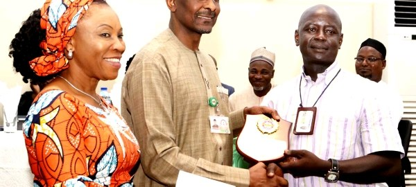Mrs Nnenna Akajemeli, National Coordinator, SERVICOM, Mr Bashir Alkali, Director, Finance and Accounts, State House and Mr Yashim Nuhu, a Senior Motor Driver Mechanic, and State House Outstanding Driver Award recipient. Thursday, April 11, 2019. Abuja. (STATEHOUSE PHOTO)