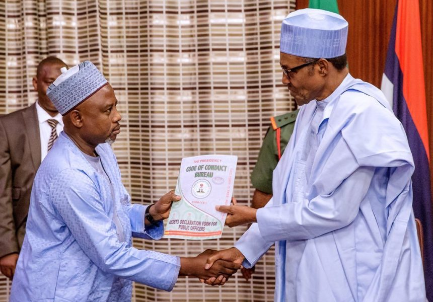 President Buhari receiving asset declaration form from Chairman of the Code of Conduct Bureau (CCB), Prof. Muhammad Isa [Photo: Presidency]