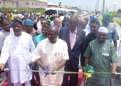 Representative of Lagos State Governor and Commissioner for Works & Infrastructure, Engr. Ade Akinsanya (middle); Commissioner for Local Government & Community Affairs, Alhaji Muslim Folami (right) and Chairman, Lekki Resident Association, Mr. Kayode Otitoju (left) during the commissioning of the Bisola Durosinmi-Etti/Hakeem Dickson Road in Lekki, at the weekend. Back row (L-R): Head of Service, Mr. Hakeem Muri-Okunola; Chairman, Zone 8, Lekki Phase1, Alhaji Rilwan Aruna; Special Adviser to the Governor, Community and Communications, Mr. Hakeem Sulaimon; Permanent Secretary, Ministry of Works & Infrastructure, Engr. Olujimi Hotonu (2nd right); Special Adviser to the Governor on Taxation and Revenue Matters, Mr. Lasisi Abdul-Fatai and Permanent Secretary, Ministry of Energy and Mineral Resources, Engr. Ajibade Caster Bade-Adebowale.