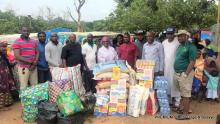 The KCOBA and the IDPs with gift items presented to the IDP's.