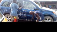 Underage kids washing cars at Mile 10, Ojo, LAgos.