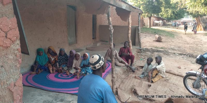 Mr. Zakariyya attending to pupils at Islamiyya school in Hara community