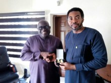 Dr Aniekeme Uwah (right) receiving the Medal of Honour award from Dr Joshua Obasanja, the AU Head of Mission in Nigeria
