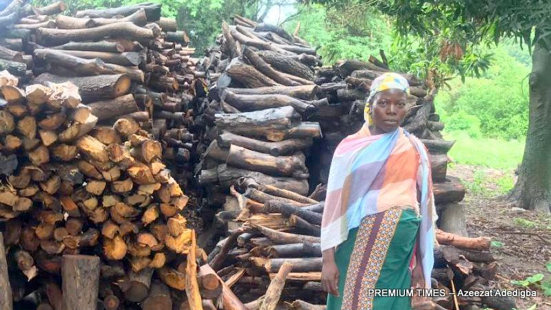One of the women farmer Christiana Ibrahim, standing by her firewood stall.