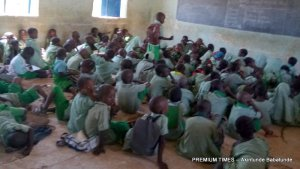 Pupils sitting on the floor in one of the schools