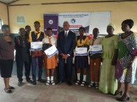 Russell Brooks with some of the students from different schools receiving their certificate of participation