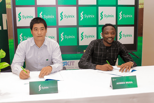 Ahmed Musa and Mr. Cana Wang, the Managing Director of Syinix Nigeria signing the contract which endorses the new brand ambassador