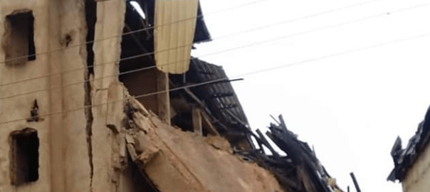 The collapsed building pictured from a few meters